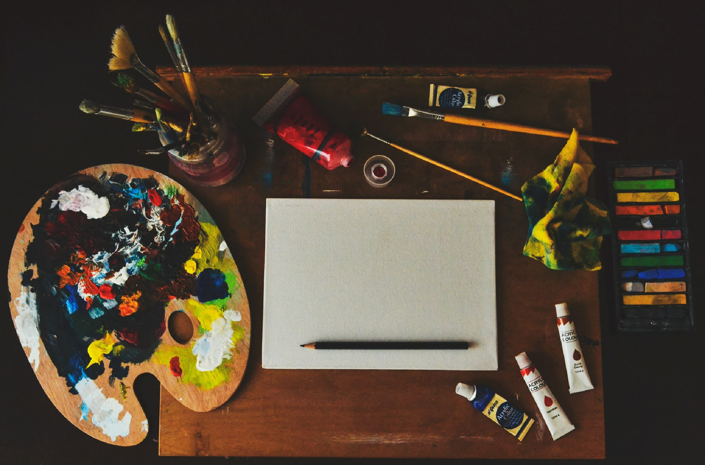 Various painting art supplies on a desk